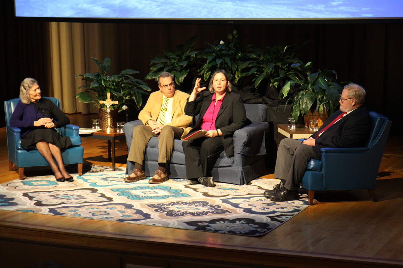 "CARE FOR CREATION: Bishop Thomas J. Tobin and the Office of Faith Formation hosted ""Lessons from Laudato Si': On Climate and the Common Good,"" an evening of reflection that brought together voices from the contemporary scientific and theological communities. Above, from left to right, Dr. Jame Schaefer, theologian, David Vallee, hydrologist, Dr. Dana Dillon, theologian, and Dr. Malcolm Spaulding, professor of ocean engineering, converse during a Q & A session following their presentations last Thursday evening."