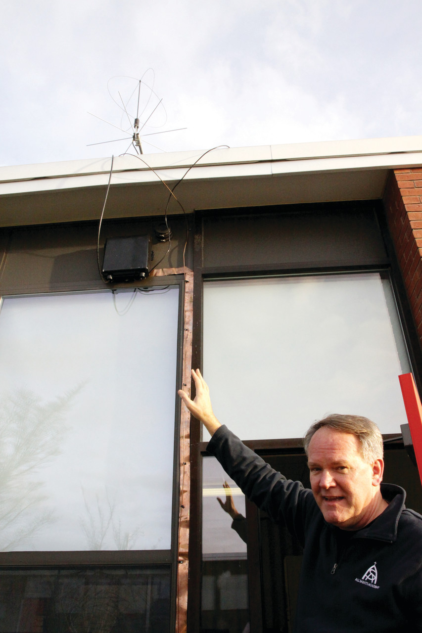 STRONG SIGNAL: Ham radio club moderator Mike Cullen points to the antenna he and ham radio club members installed on the school roof in preparation for the call to the International Space Station.