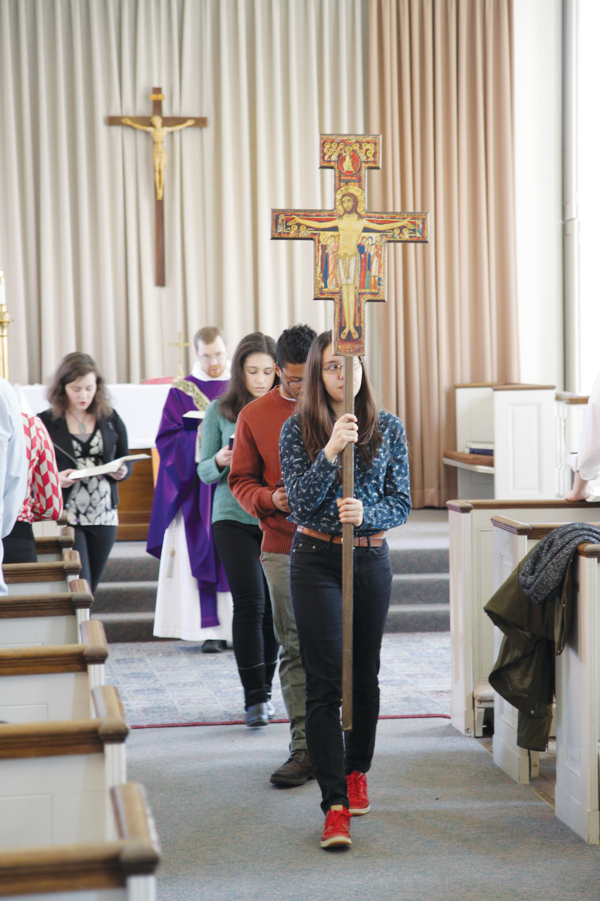 CATHOLIC COMMUNITY: Alicia DeVos, a Brown University sophomore, leads the closing procession at a February 28 Alumni Mass.