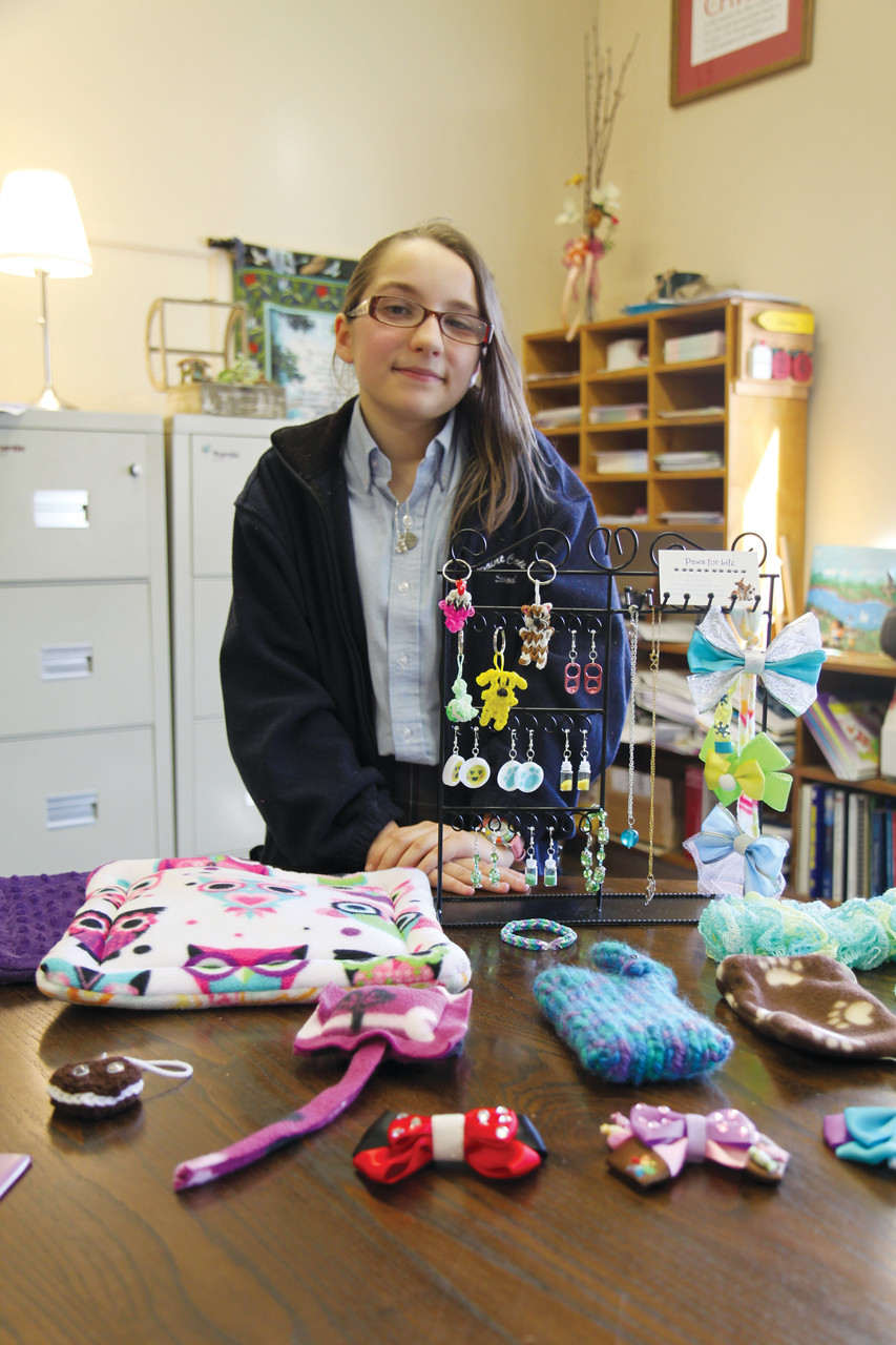 Sarah Coutu, a sixth grader at St. Cecilia School, Pawtucket, has been chosen as a Rhode Island recipients of the 2016 Prudential Spirit of Community Award for their commitment to volunteer work. Coutu makes and sells craft items to raise money for no-kill animal shelters through her organization, Paws for Life,