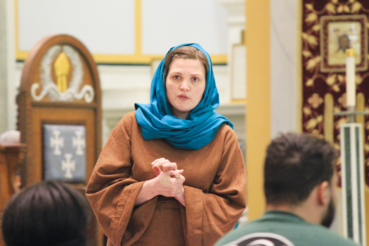 A BLESSED PERSPECTIVE: Liz Montigny, a parishioner at Holy Name of Jesus Parish in Providence portrays Mary in her one-woman show about the death of Jesus through the eyes of his loving mother.