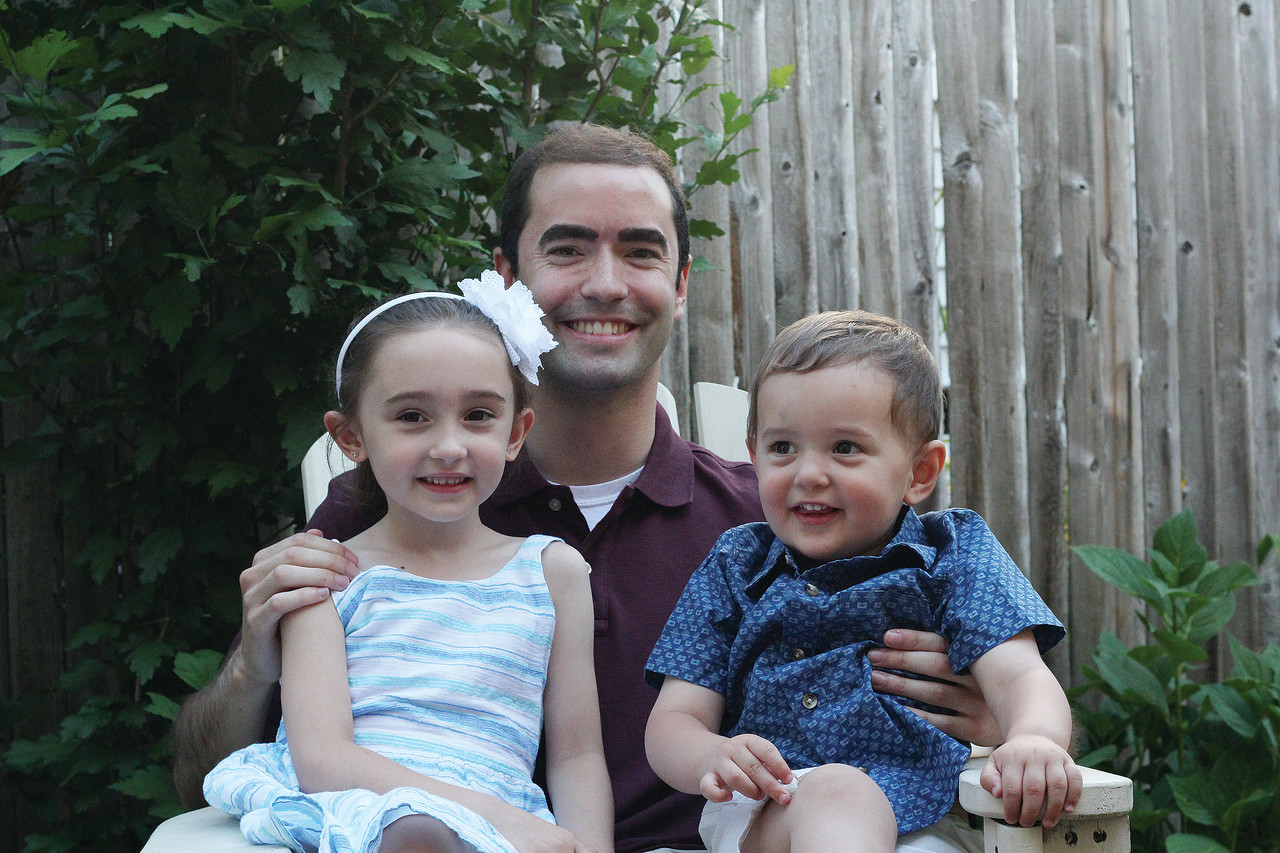 Family Support: Deacon Nathan Ricci smiles with his niece and nephew, Mia Ricci, 4, and Domenic Ricci, 20 months.