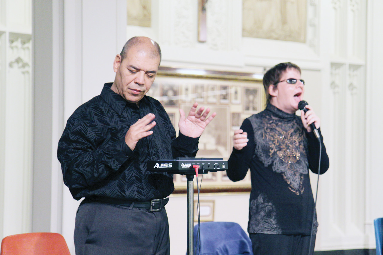At left, percussionist Henry Rodriguez and vocalist Diane Parenteau perform with the group Blind Faith at a reception following the pilgrimage to the Holy Door. The members of the band, which also includes keyboardist Matthew Ventre, have all been blind since birth.