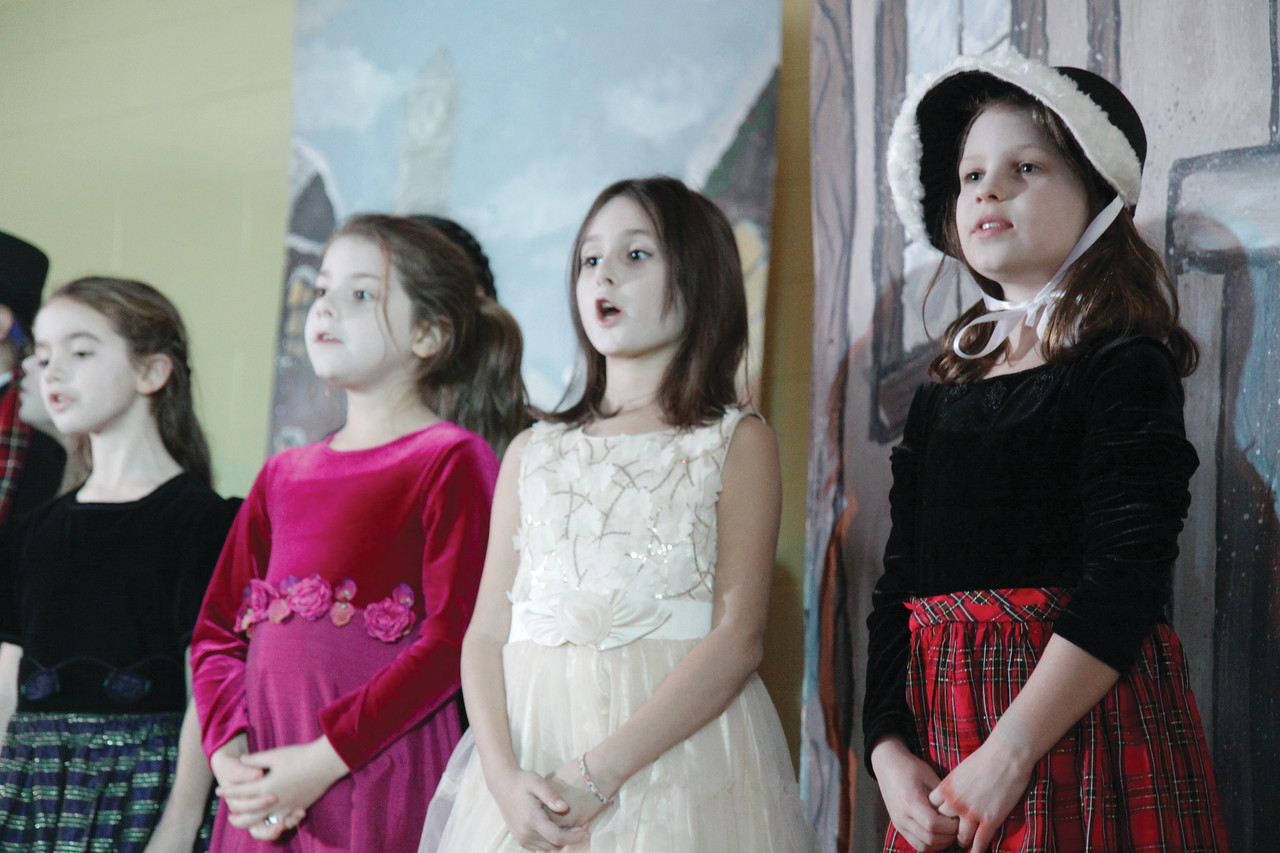 From left to right, Grace Powers, Chloe Rocheleau, Kathryn Pike and Madeline Rupert perform in the play's ensemble.
