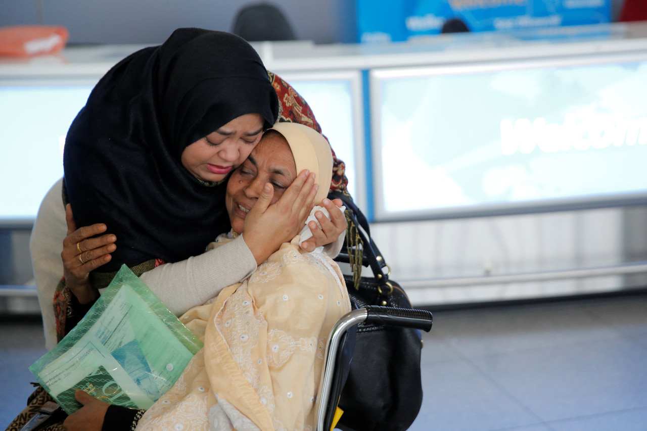 A woman greets her mother after she arrived from Dubai at John F. Kennedy International Airport in New York City Jan. 28.