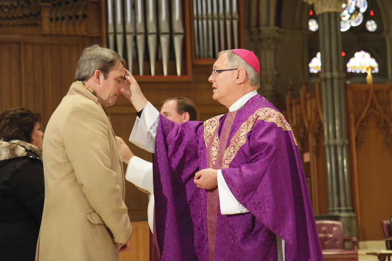 LENTEN OBSERVANCE: Bishop Thomas J. Tobin distributes ashes last year on Ash Wednesday at the Cathedral of SS. Peter and Paul in Providence.