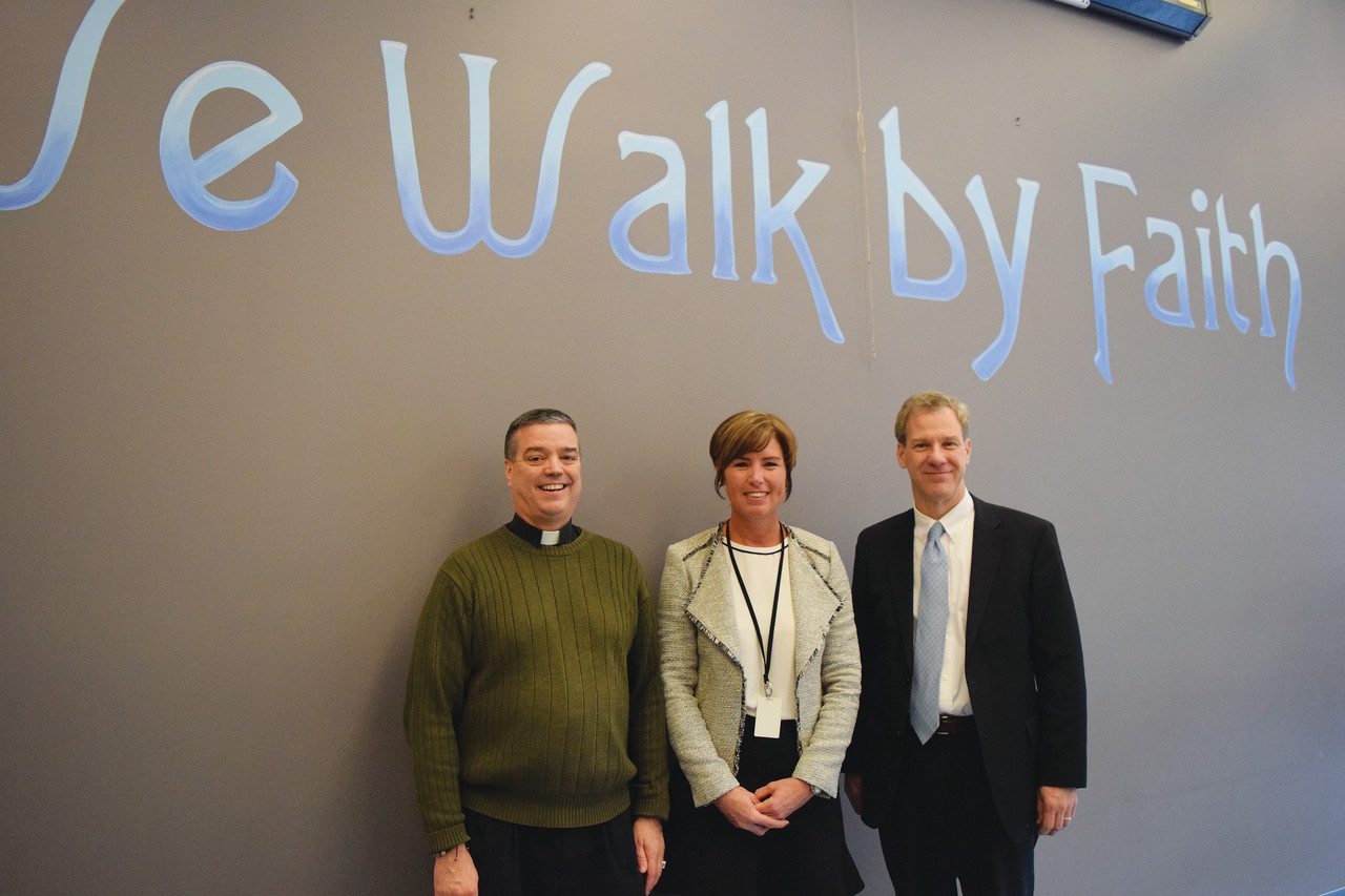Father John Soares, Principal Mary DiMuccio and Dan Ferris following the presentation.