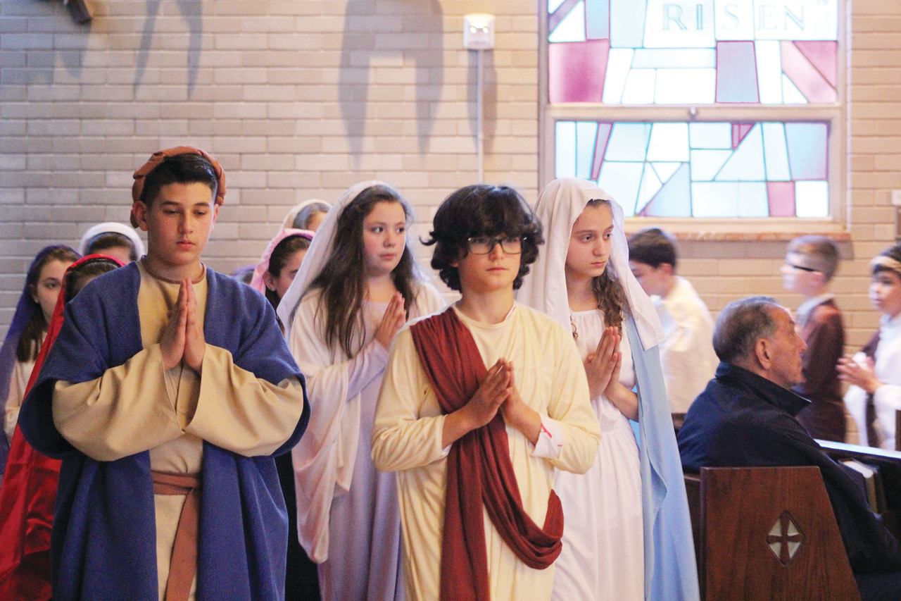 Students from St. Augustine School in Providence celebrate the Resurrection of the Lord during their Living Stations