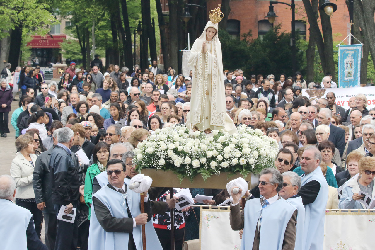 Heaven Sent: Celebrating the 100th anniversary of the Fatima apparitions, pilgrims hold a procession in Cathedral Square before Mass at the cathedral.