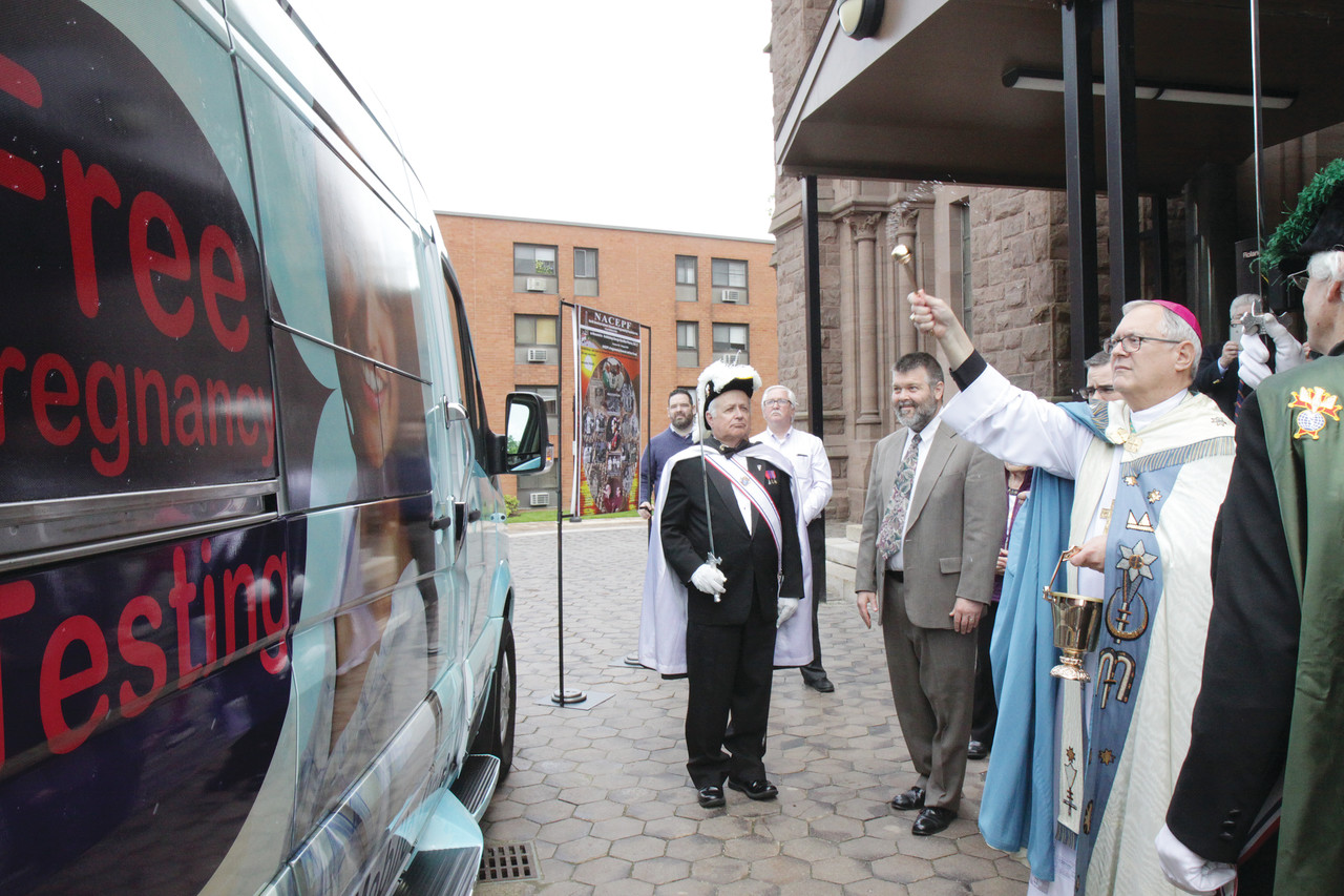 "Bishop Thomas J. Tobin offered a blessing over the new mobile ultrasound clinic at the dedication ceremony. ""It will be a wonderful resource for the pro-life ministry in our community and I have no doubt that the lives of unborn children will be saved because of that new vehicle,"" he said."
