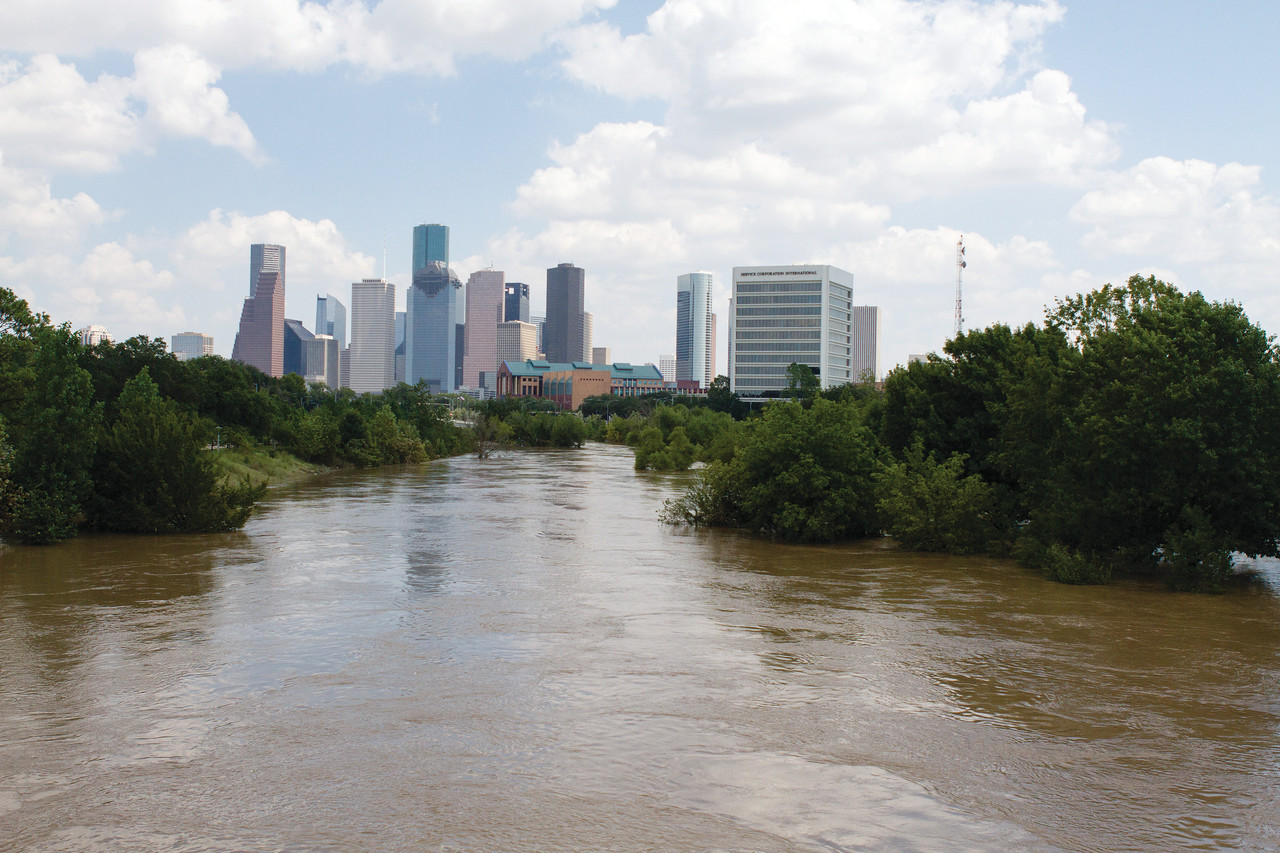 Houston's skyline is seen as Buffalo Bayou still floods past its banks near downtown Houston Aug. 31 in the aftermath of Tropical Storm Harvey. The Buffalo Bayou, which courses through the nation's fourth largest city, surged past record numbers and flooded thousands of homes in Houston.