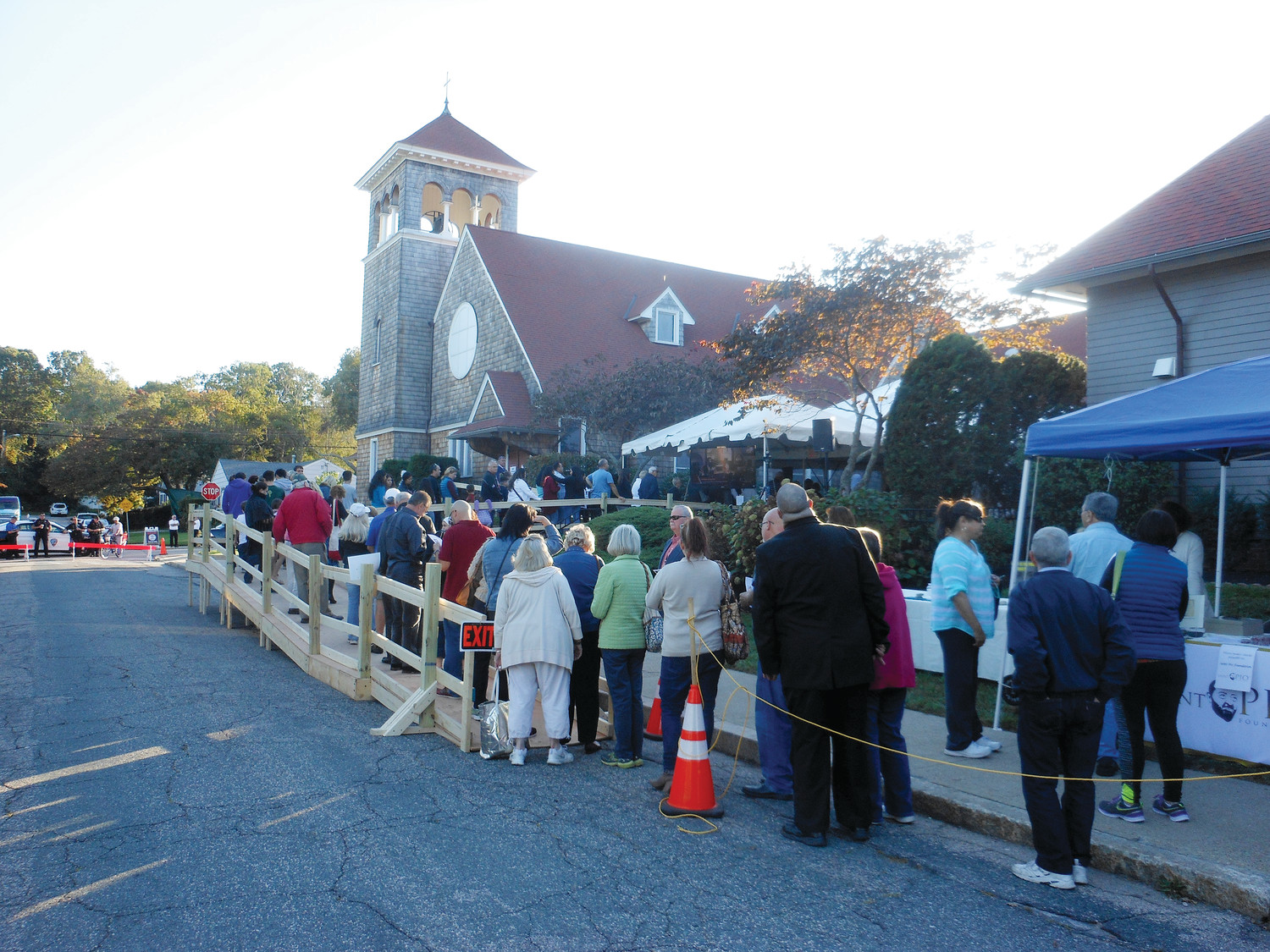 Crowds gather outside of St. Thomas More Church in Narragansett to venerate the relics of St. Padre Pio.