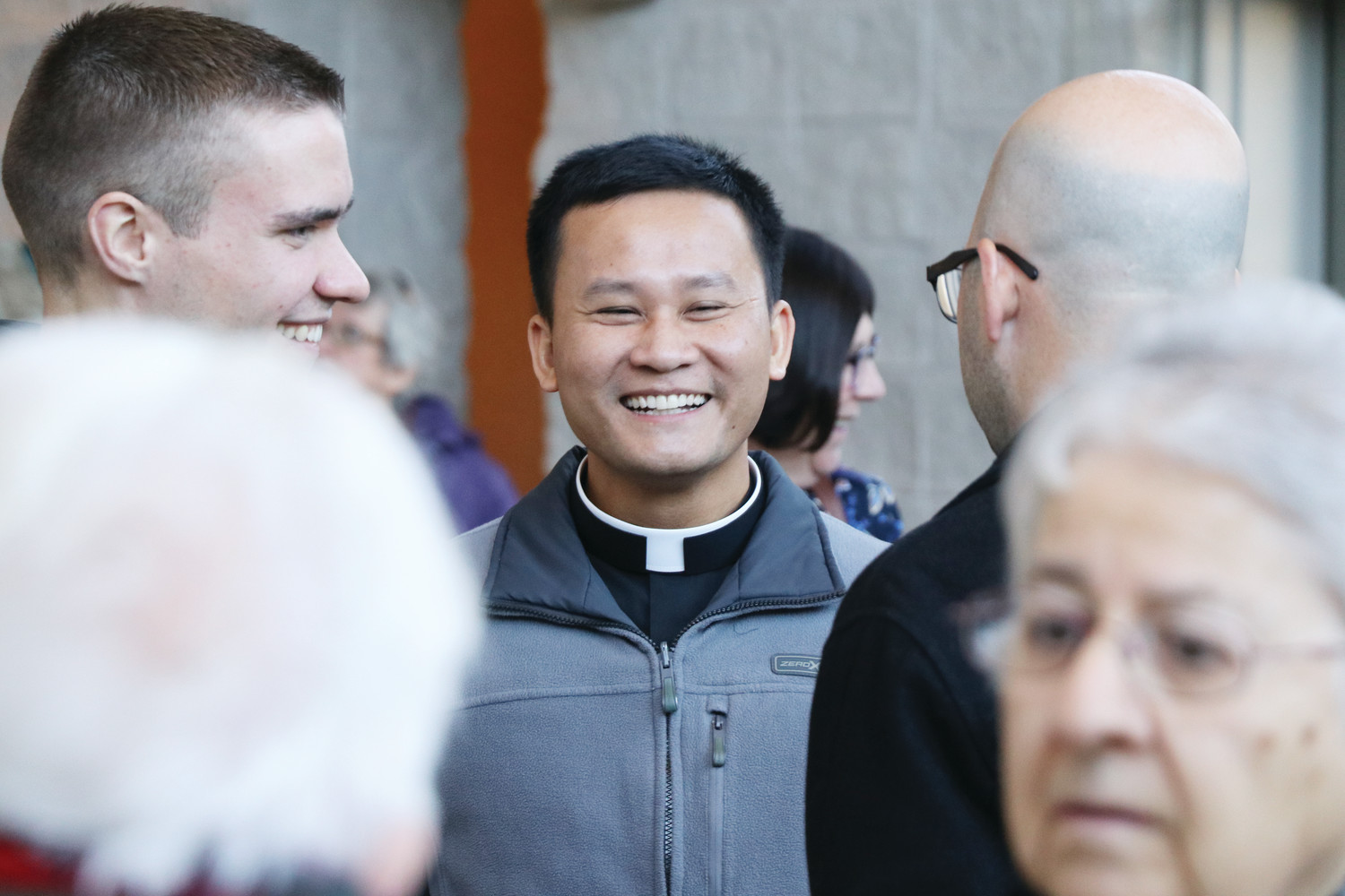 Second Theology Seminarian Hiep Nguyen enjoys fellowship with fellow seminarians before a noon Mass in the La Salette Chapel.