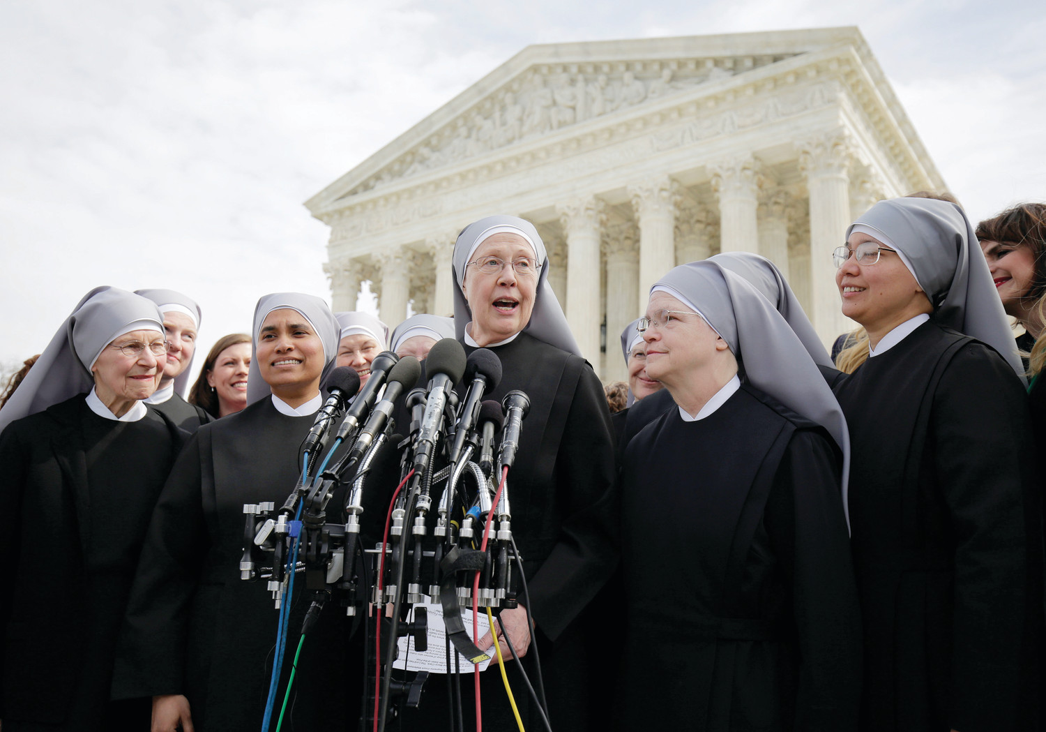 Sister Loraine Marie Maguire, mother provincial of the Denver-based Little Sisters of the Poor, speaks to the media outside the U.S. Supreme Court in Washington March 23 after attending oral arguments in the Zubik v. Burwell contraceptive mandate case. (CNS photo/Joshua Roberts, Reuters) See SCOTUS-ZUBIK-BURWELL- March 23, 2016.