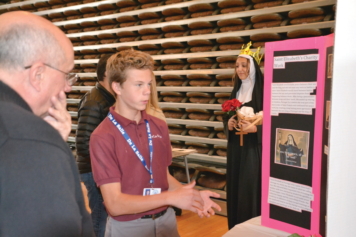 Father Thomas Woodhouse, school chaplain, learns about St. Elizabeth.