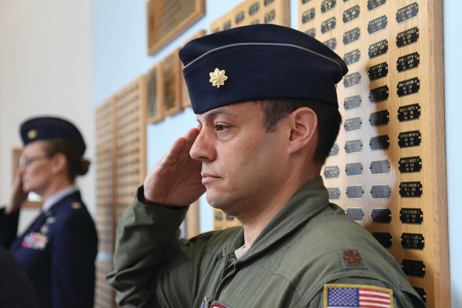 Major Jim Couture of the Rhode Island Air National Guard salutes during the ceremony. Couture is a graduate of the Mount St. Charles class of 1992.