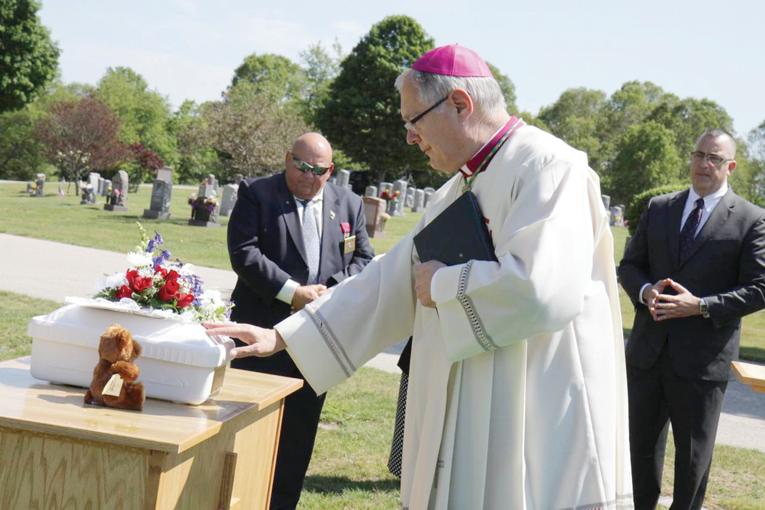 "In June 2015 in a simple, but dignified ceremony in a section of Gate of Heaven Cemetery set aside for the repose of babies, Bishop Tobin presided over a Christian burial service for the unborn child he named ""Francis,"" fulfilling a commitment he made to officials five months before after a fetus was found floating amid the sewage at a nearby wastewater treatment facility. The tiny white casket, with ""Baby Francis 2015"" inscribed on a gold plaque affixed to one end, and flanked by flowers and a small teddy bear, rested upon a portable pine altar as the burial service was conducted."