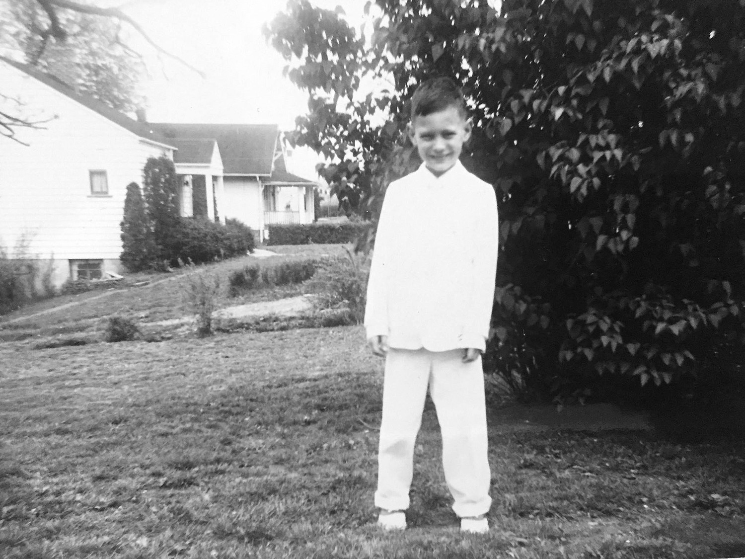 The bishop dresses in his finest on the day of his first holy Communion, Sunday, May 13, 1956 at St. Teresa of Avila Parish in the Diocese of Pittsburgh.
