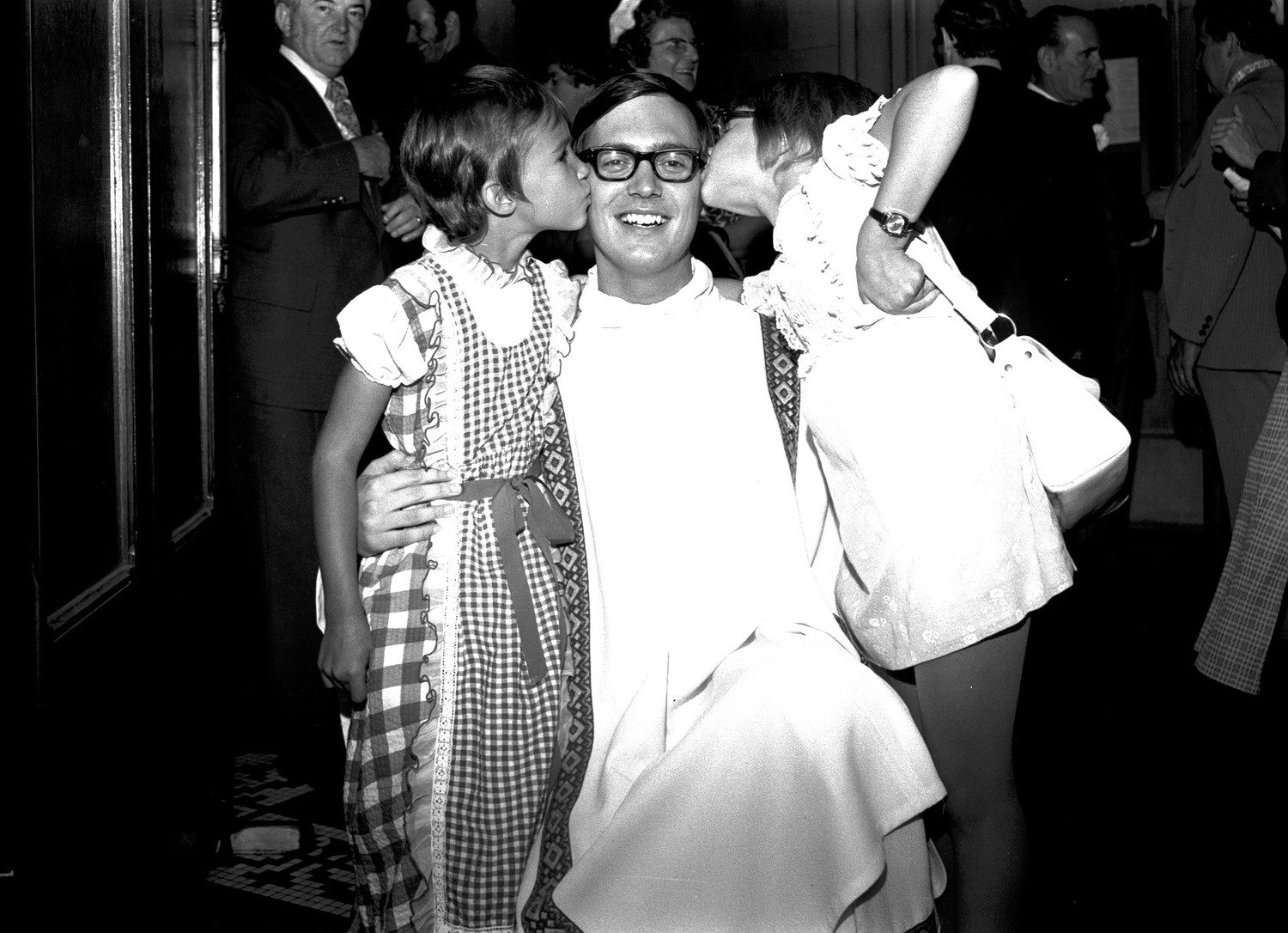 After being ordained at St. Paul Cathedral on July 23, 1973, Father Thomas J. Tobin of Perrysville, Pennsylvania, received congratulations from his two small nieces, Susan Kreutzer, left, and Brigitte Tobin.