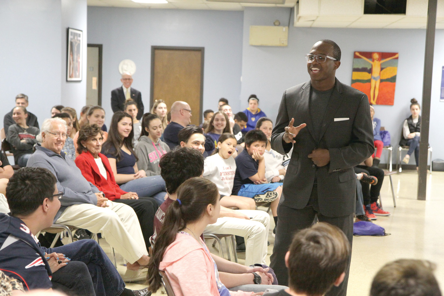 Matthew Slater, #18 on the New England Patriots where he plays special teams, spoke about the strong role that faith continues to play in his life during a visit to Mary, Mother of Mankind Parish in an event for young people and their families celebrating the parish's 50th anniversary.