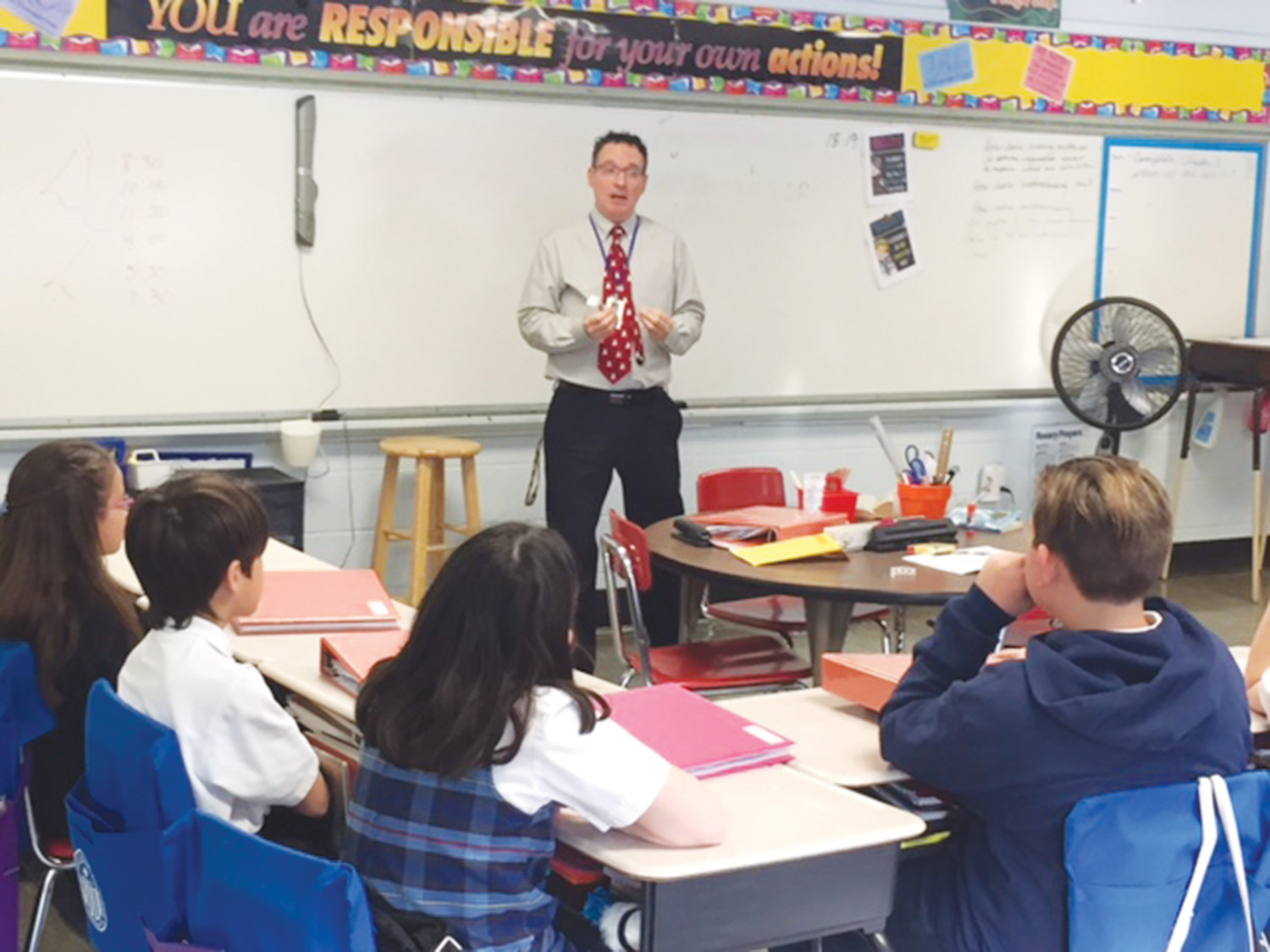 Mr. David Pregana, Director of Special Education, works with a fifth grade class at Mercymount.