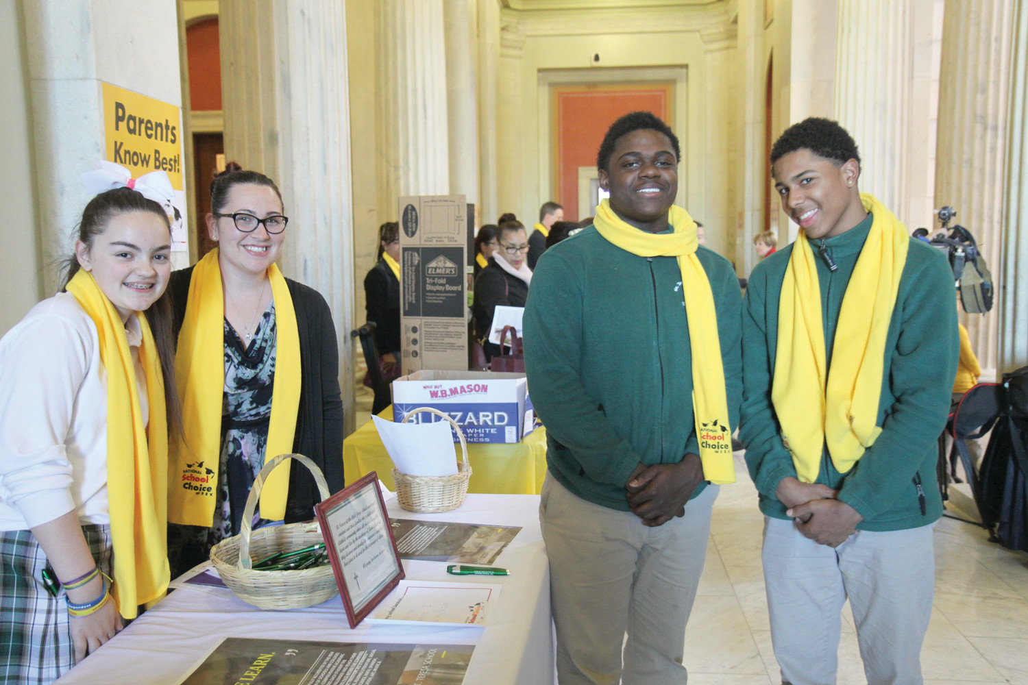 Students from St. Teresa School, Pawtucket, stand with their principal, Allison Amodie, to represent their school at the annual School Choice Rally at the Rhode Island State House. From left to right are sixth-grader Hannah Guevremont, Principal Amodie and eighth graders Elijah Osei and Henique Ross.