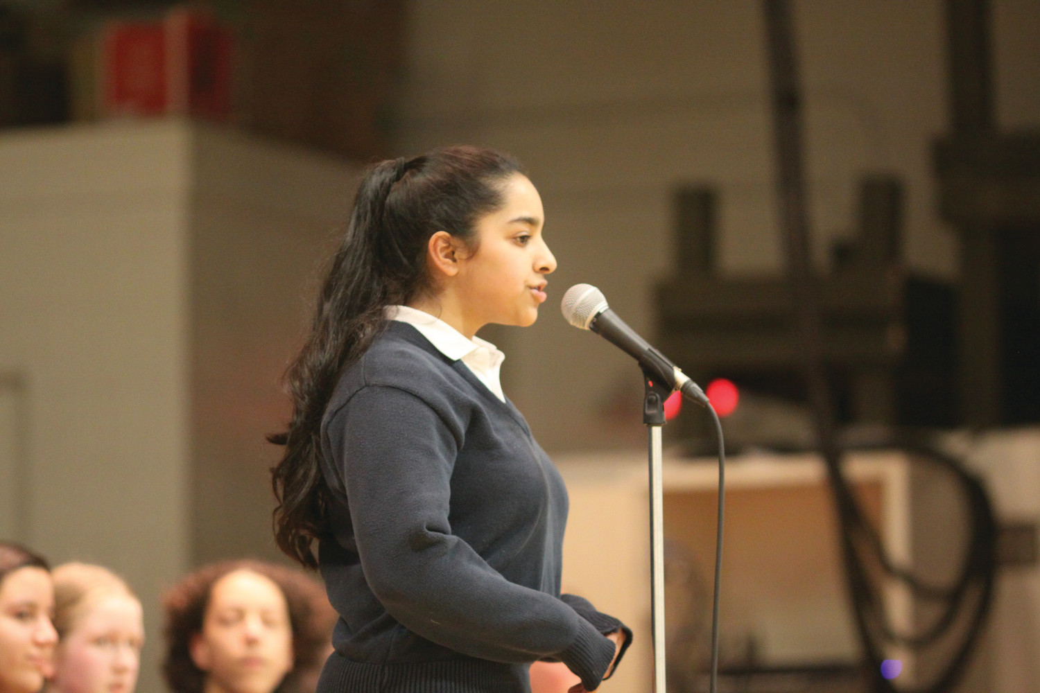Mercymount Country Day School, Cumberland, eighth grader Shivani Bedre competes in the first round of the diocesan spelling bee.