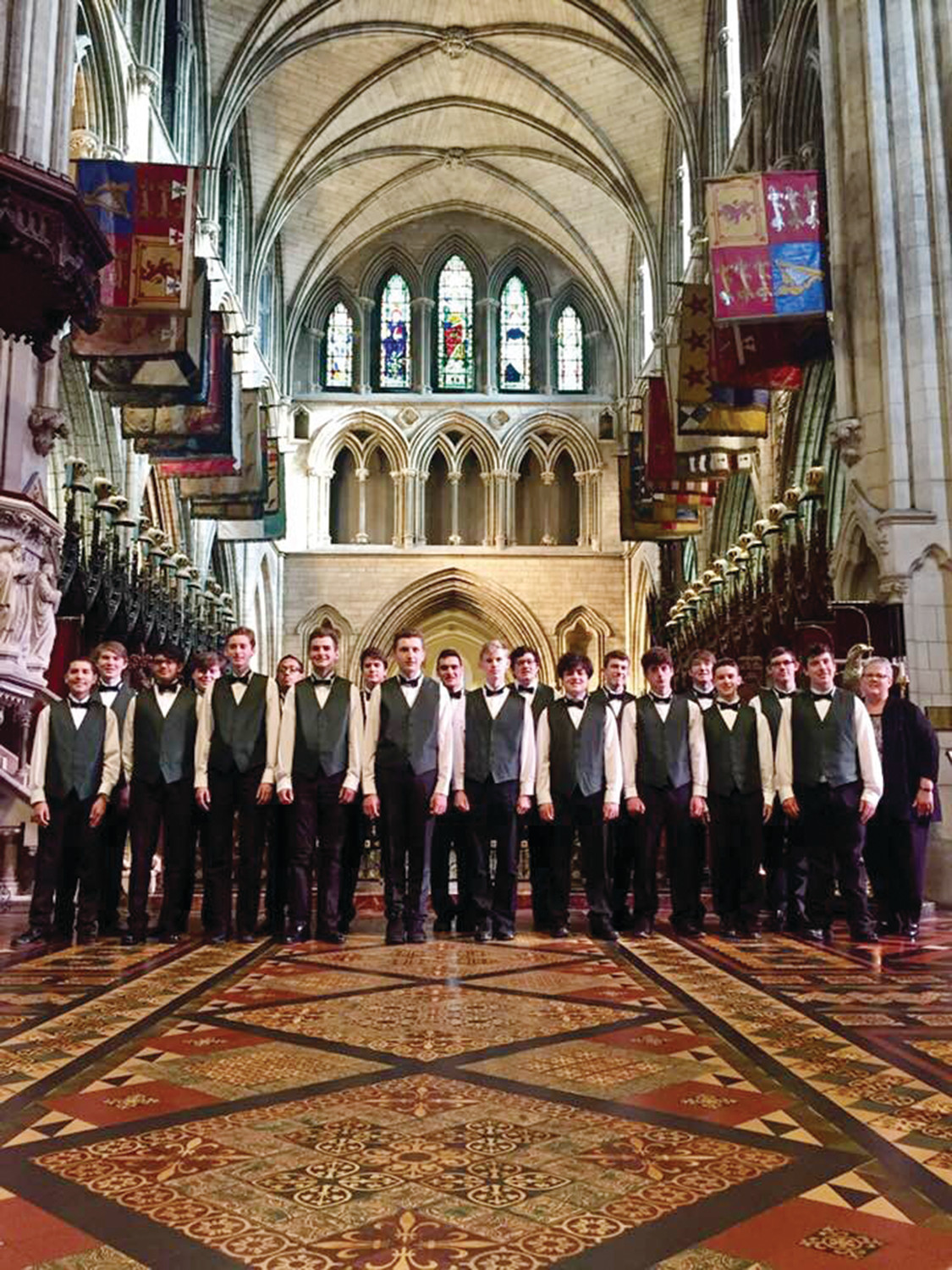 The Bishop Hendricken Young Men's Chorus stands within St. Patrick's National Cathedral of the Church of Ireland during a 10-day pilgrimage.