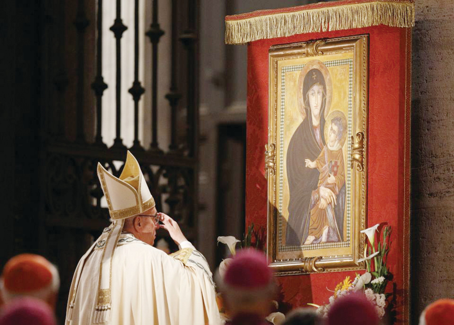 Pope Francis venerates a Marian image outside the Basilica of St. Mary Major in Rome in this May 26, 2016, file photo.
