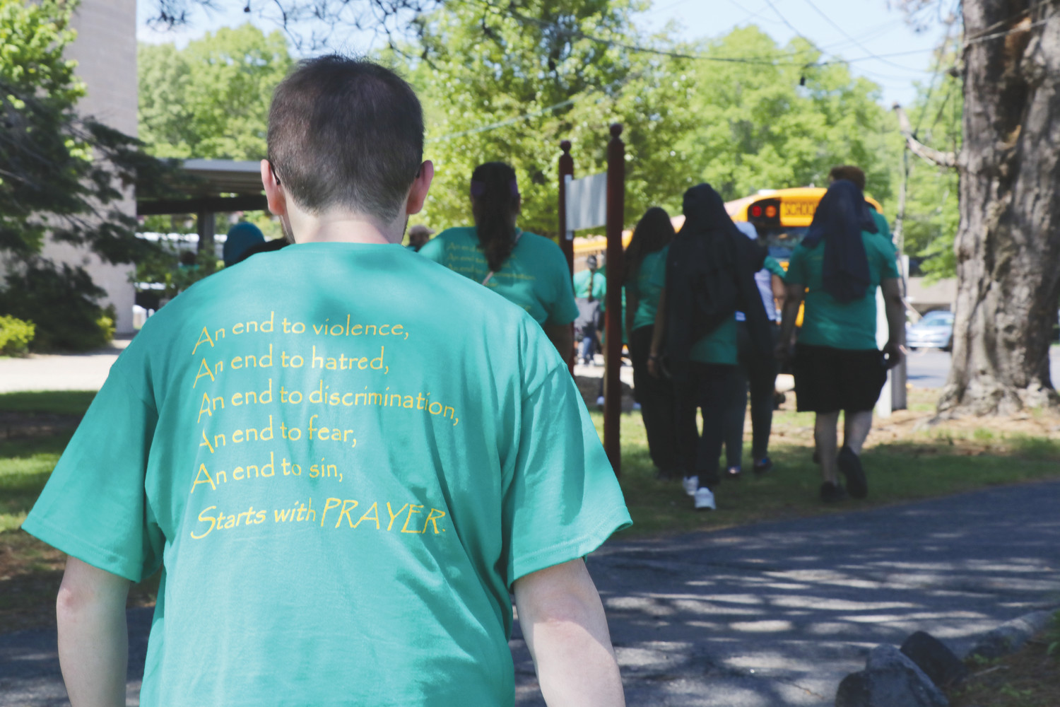 Students and staff wore shirts with a hopeful message that making peaceful and effective changes in society should always start with prayer.