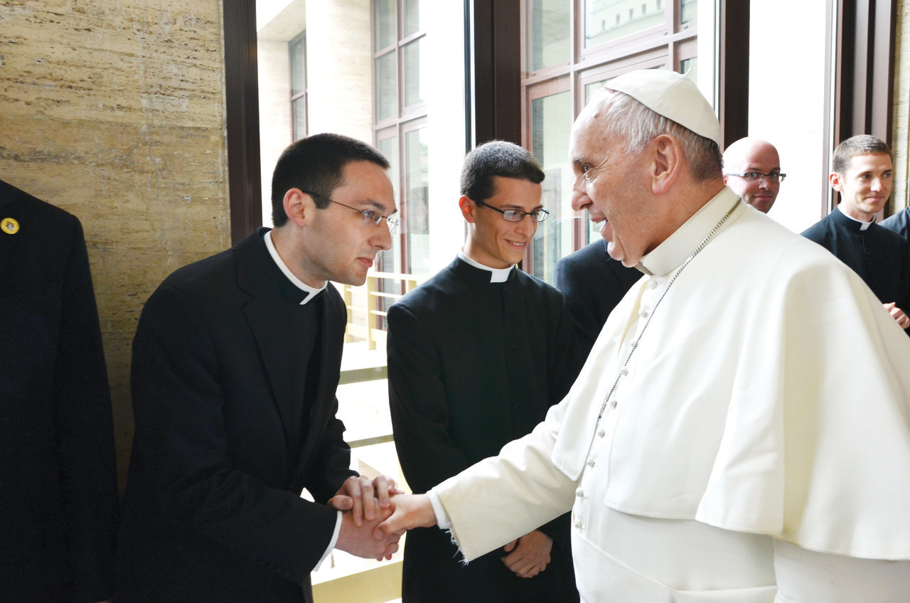 Pope Francis greets Deacon Phillip Dufour in 2015 when he was a first year seminarian studying at Rome's Pontifical North American College. At left,