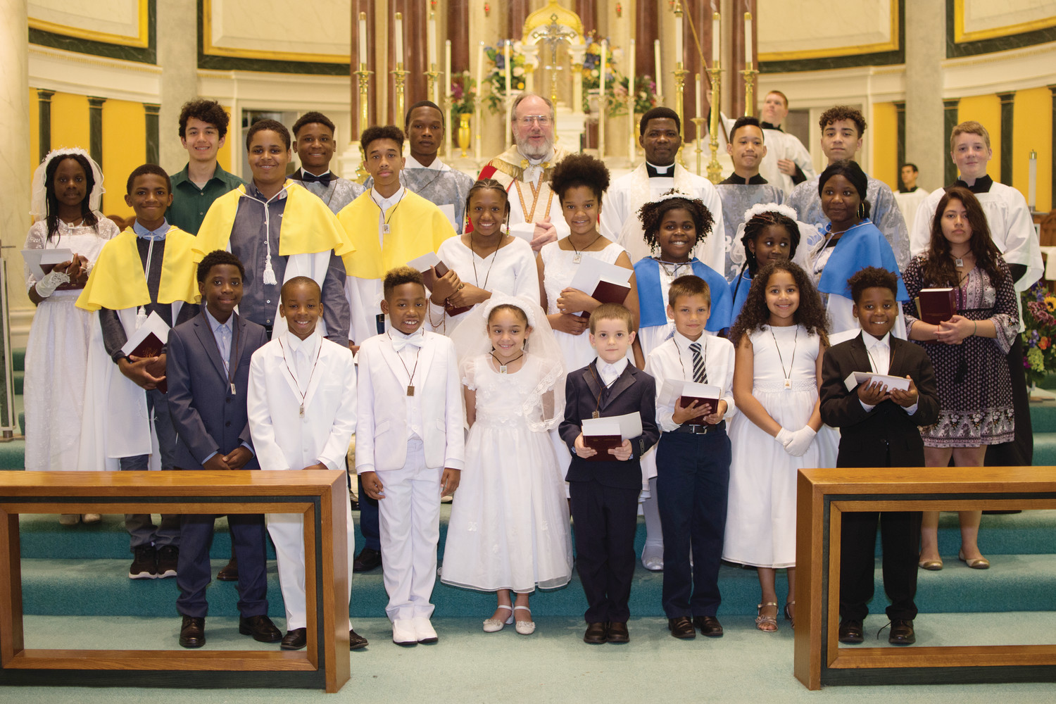 On Sunday, May 27, fifteen children and teens from Holy Name of Jesus Church in Providence received their First Holy Communion.