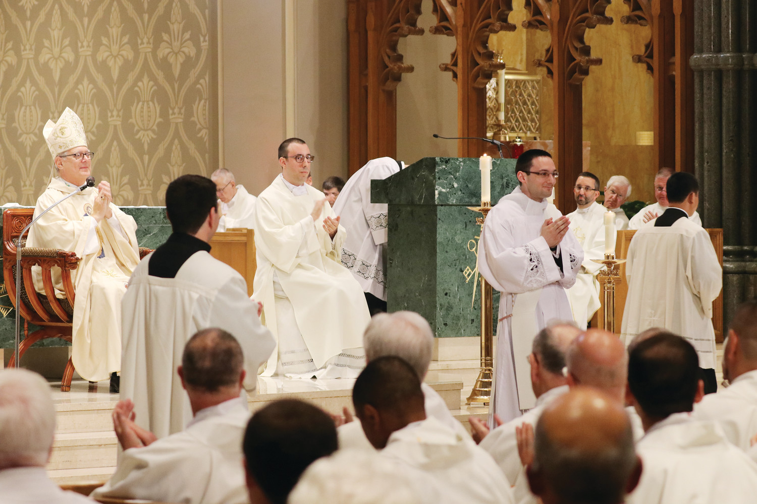 Bishop Tobin leads everyone in attendance in applauding Father Dufour on the occasion of his ordination to the priesthood.