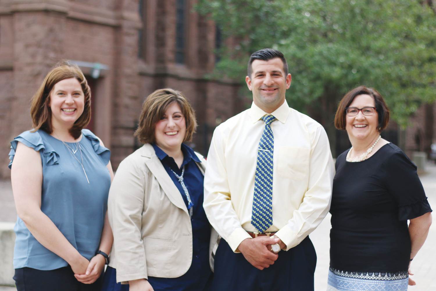 From left, earlier this summer, Jessica Walters, Erin Clark, Mark DeCiccio and Mary-Regina Bennett visit the Catholic School Office for a welcome meeting. Not pictured Maurice (Mo) Guernon and Susan Morrissey. The Diocese of Providence welcomed six new Catholic School principals to begin serving for the 2018-2019 school year.