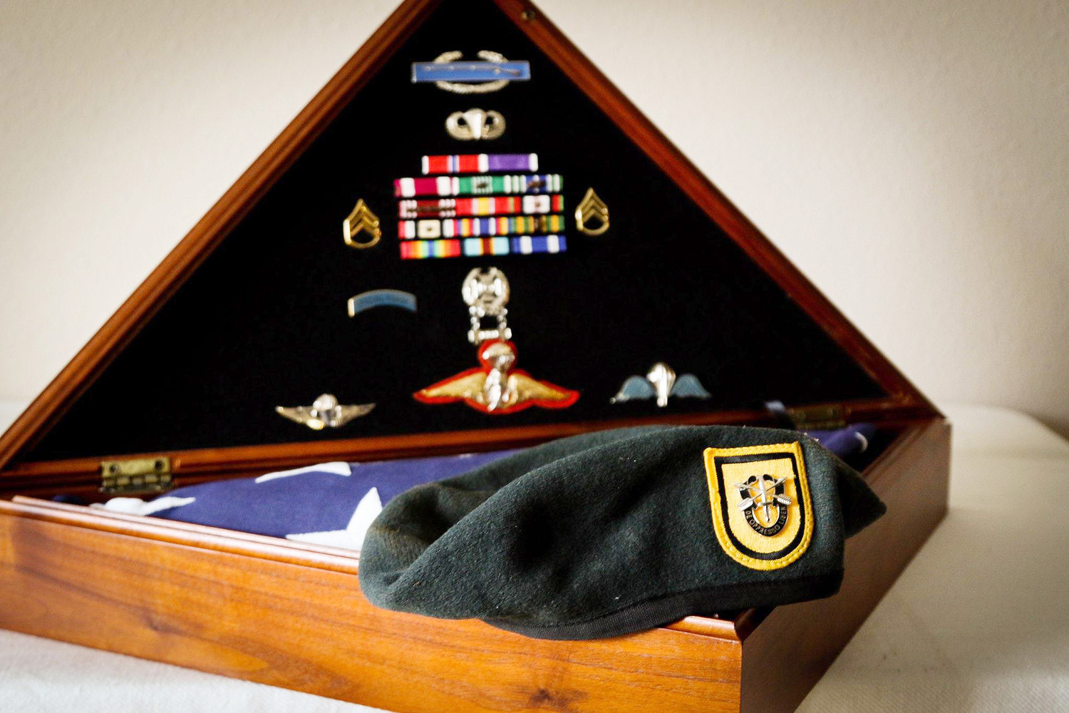 A treasured photo shared by Krista Simpson Anderson, shows her late husband's flag, beret and medals. In 2013, SSG. Simpson, who courageously served in the Special Forces, died from injuries sustained in a roadside bombing in Afghanistan.