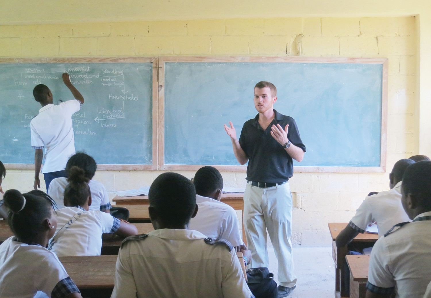 United States volunteer Connor Branham teaches economics class to The Louverture Cleary School students. The Haitian Project is confident that the payoff for Haiti will be significant and that the Network will be nothing short of a catalyst for robust institutional and economic growth.