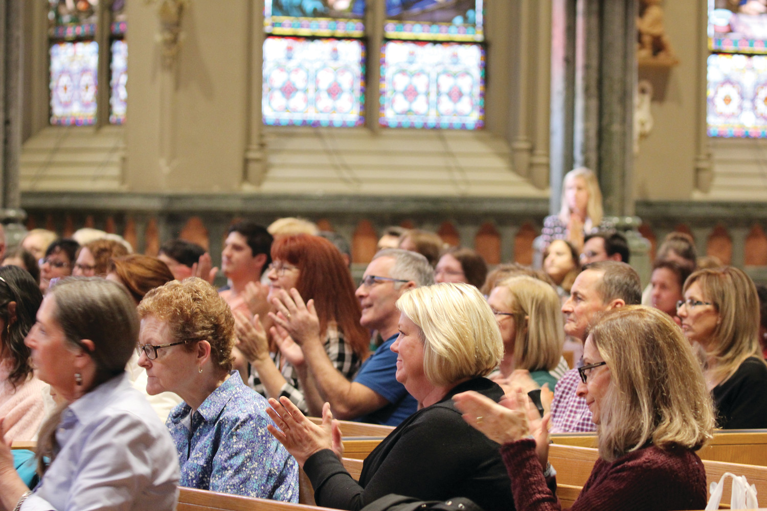 "Attendees to this years ""Truth, Goodness and Beauty"" event at the Cathedral of Saints Peter and Paul, Providence applaud Abby Johnson, well-known pro-life speaker and former clinic director of Planned Parenthood Johnson, who spoke at Saturday's event."