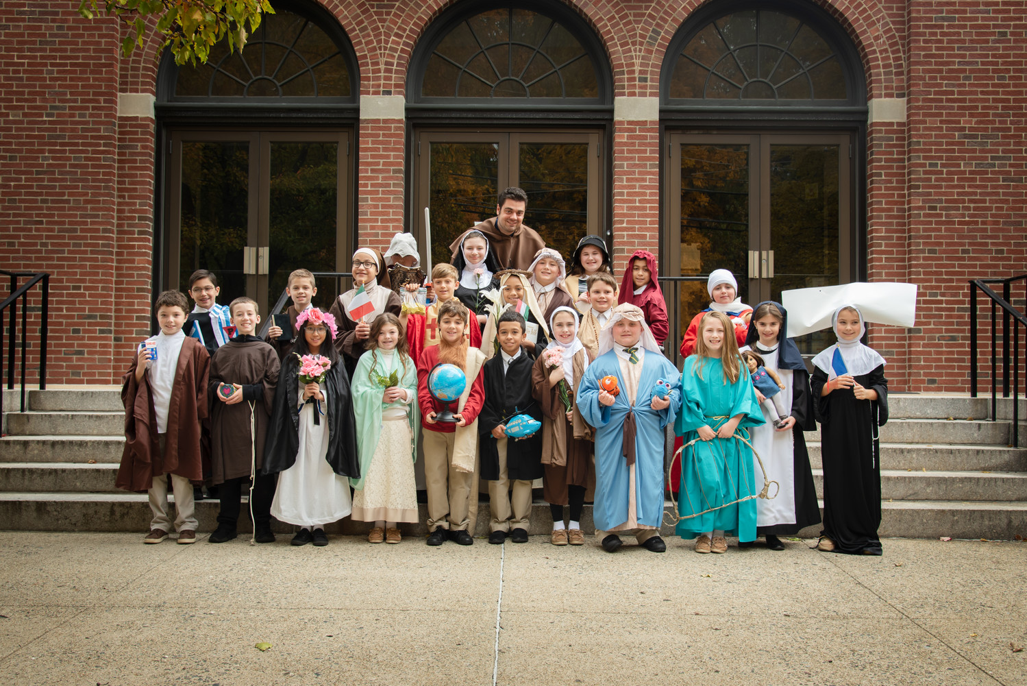 Ralph Cola's fourth grade class at St. Augustine School recently chose a saint to learn about, and on Thursday, Nov. 1, toured the school in costumes representing their saint and sharing facts and special details.