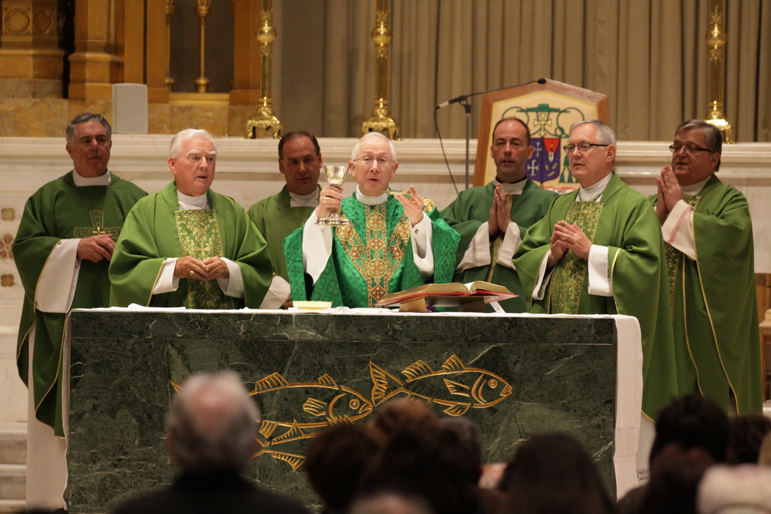 Archbishop Leonard Paul Blair serves as the main celebrant at the noon Mass at the Cathedral of SS. Peter and Paul in this May 17, 2016 file photo. Pictured from left, Father Jonathan DeFelice, O.S.B., then-assistant moderator of the curia and vice chancellor; Bishop Emeritus Robert E. Mulvee; Msgr. Albert A. Kenney, vicar general and moderator of the curia; Archbishop Blair; Father Timothy D. Reilly, diocesan chancellor; Bishop Thomas J. Tobin; and Msgr. Anthony Mancini, rector of the Cathedral of SS. Peter and Paul.