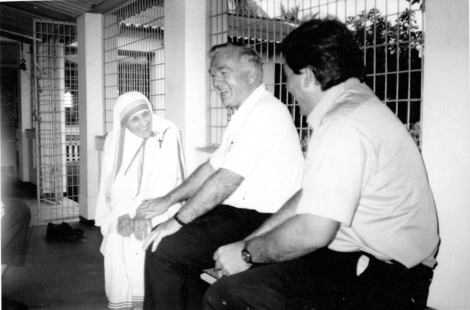 Bishop Mulvee laughs with Mother Teresa in Calcutta during a Catholic Relief Services visit in 1989.