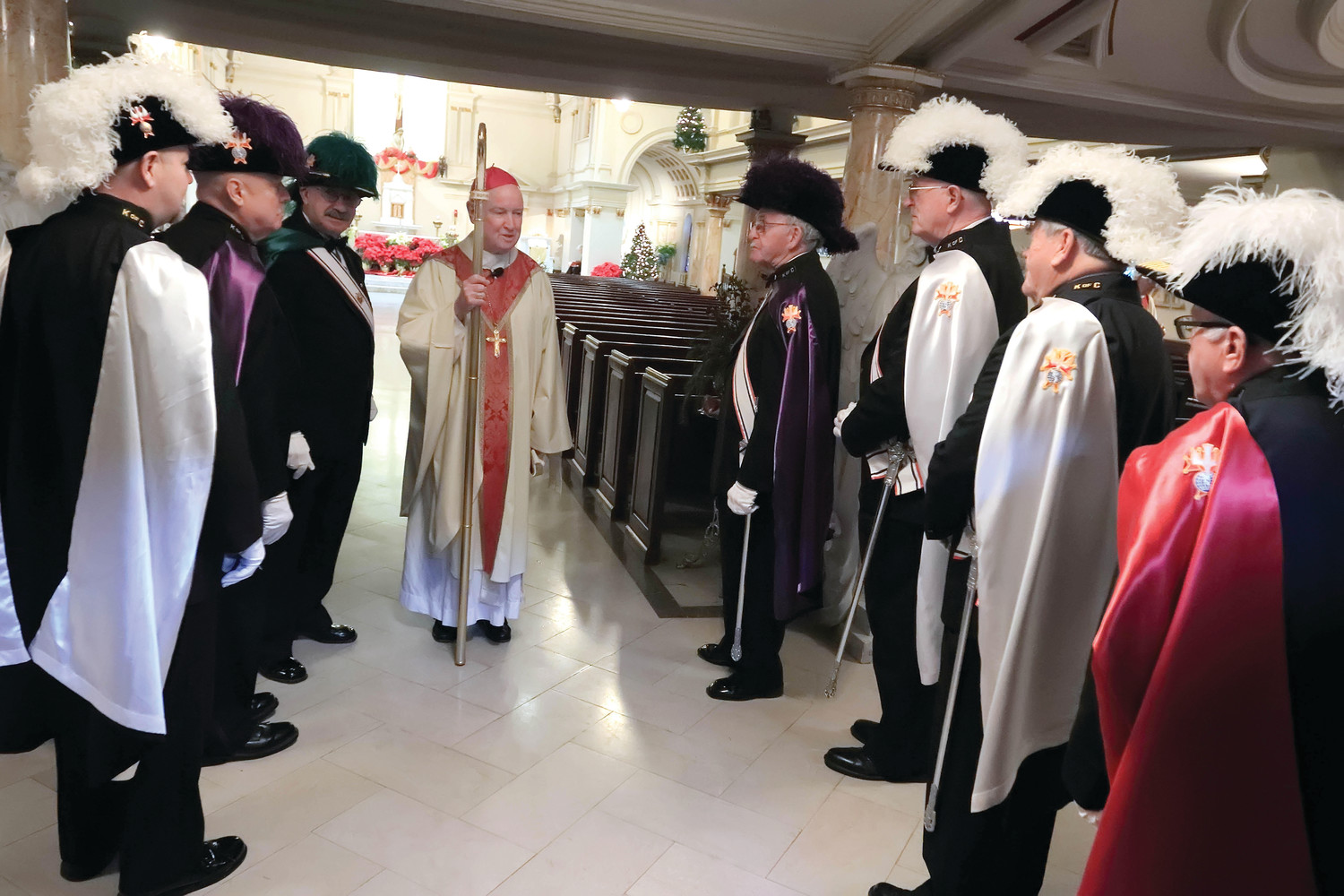 Bishop Malooly talks with members of the Knights of Columbus before the memorial Mass for Bishop Robert Mulvee at the Cathedral of Saint Peter Church, January 13, 2019.