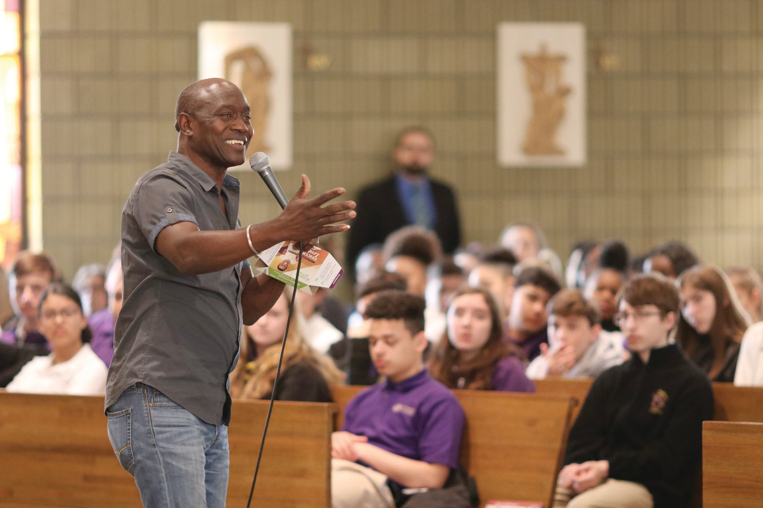 Thomas Awiapo speaks to students at St. Raphael Academy about his experiences growing up as an orphan in Ghana in which he was rescued from extreme hunger through his participation in an education initiative sponsored through the CRS Rice Bowl program.