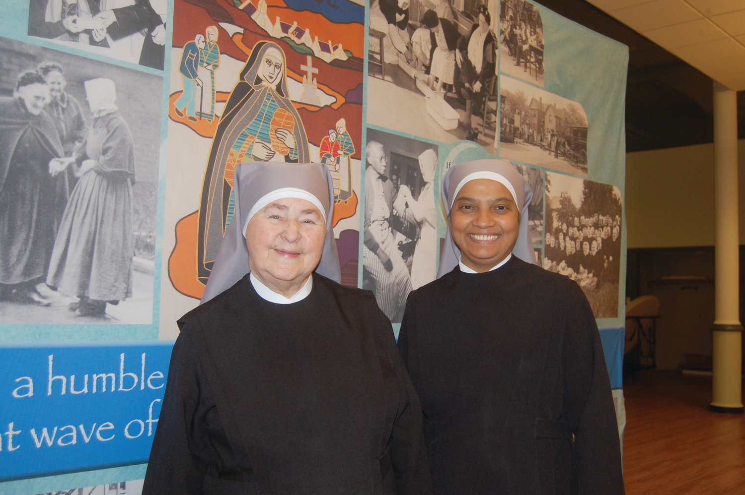 Sister Mary Agnes, left, administrator of St. Jeanne Jugan, and Sister Mercy Stella Theresa, Mother Superior, smile during the special anniversary celebration on Saturday, May 4, at the cathedral. The Little Sisters of the Poor trace their history in Rhode Island to 1881, when five Little Sisters traveled from France to open a home in Providence. In 1979, they opened their current home, the Jeanne Jugan Residence in Pawtucket. The home currently serves approximately 100 residents, including 27 independent living apartments.