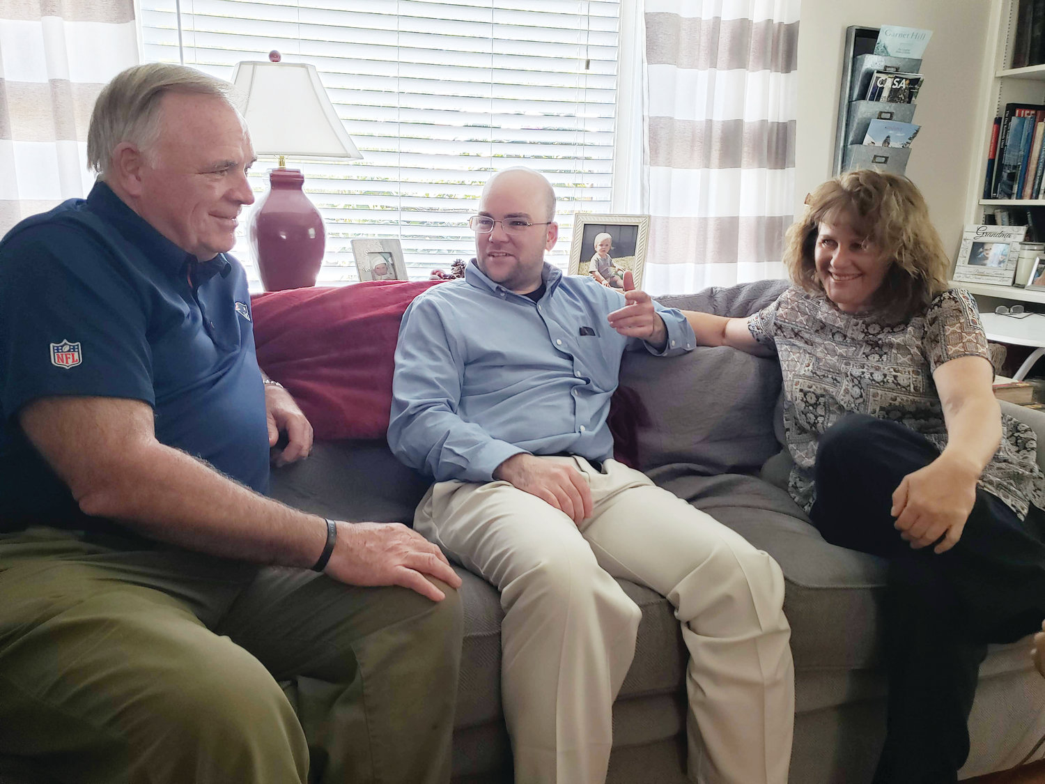 Deacon Brendan Rowley visits with his parents, James and Deborah Rowley, in the family's Narraganset home a couple of weeks before his ordination.