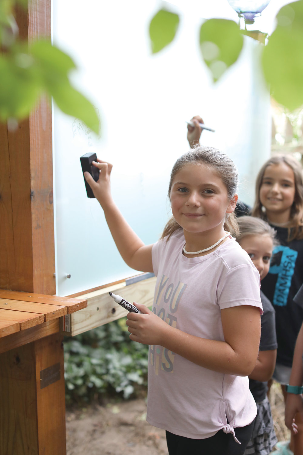 Shortly before the first day of school, students, parents and teachers help put the finishing touches on the Sister Mary Angelus Outdoor Classroom.