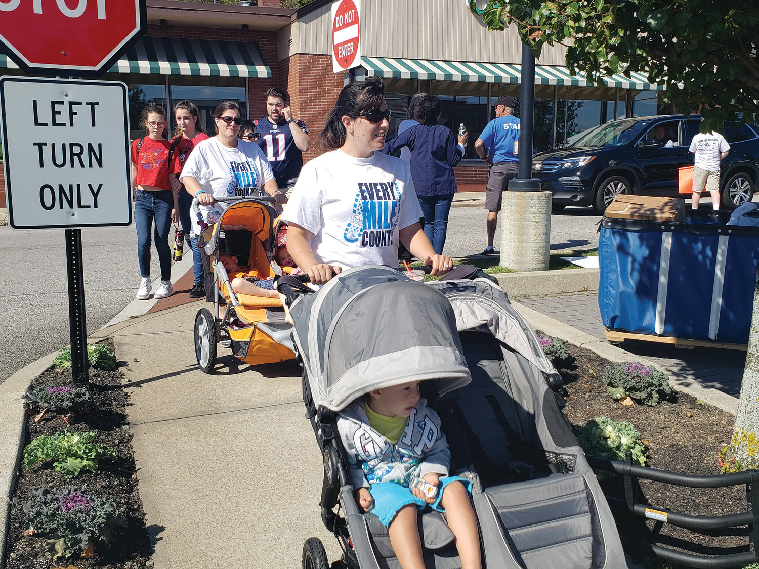 Hundreds gathered for the 12th annual St. Vincent de Paul Friends of the Poor Walk on Sept. 29 in Garden City Center, Cranston. Funds raised from the walk help to provide food, clothing, medicine, housing assistance, transportation and utility costs, job training and placement, and disaster relief to those in need.