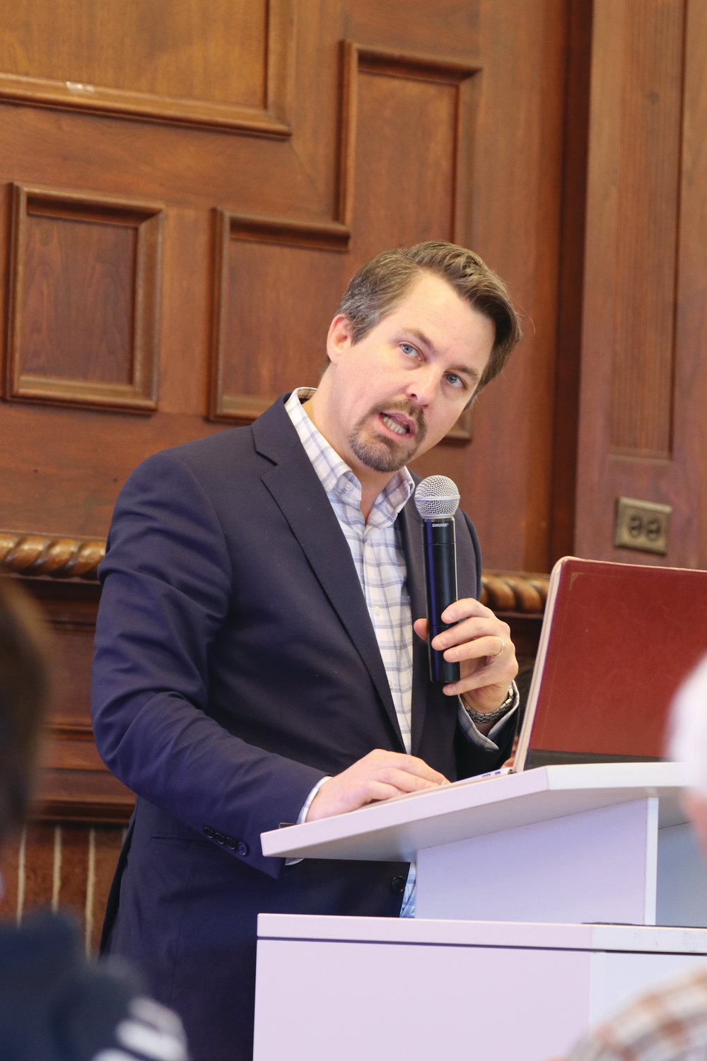 Dr. Chad Pecknold, associate professor of theology at Catholic University of America, offers his presentation during the first forum in the diocese's Caring for Creation series, held on Oct. 19 at Providence College.