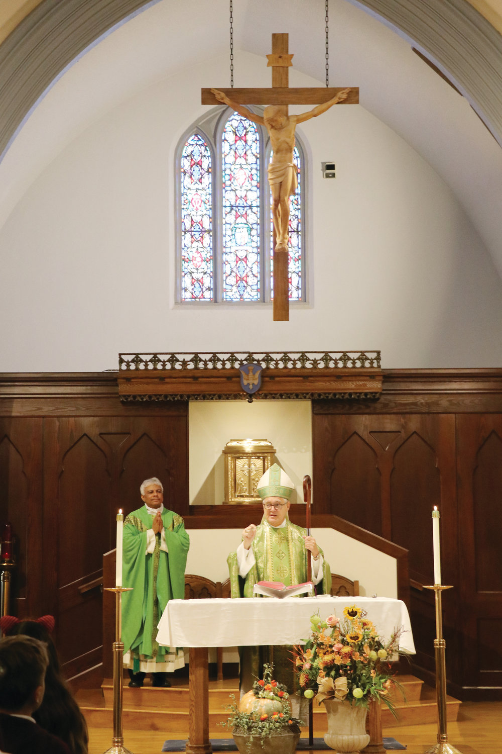 Father TJ Varghese concelebrates Mass with Bishop Tobin.