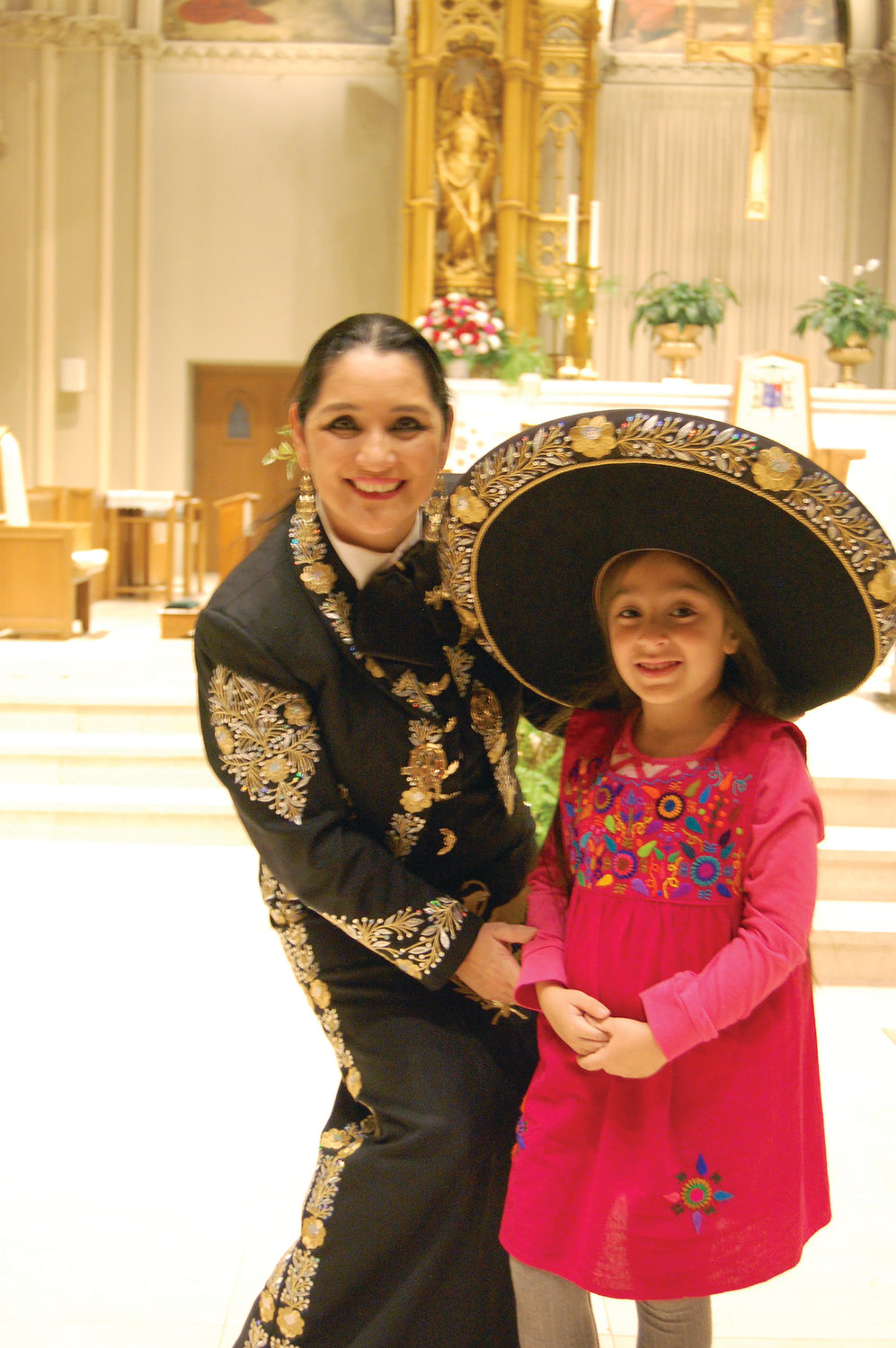 Singer Veronica Robles with Iracema Monterroso-Perin, 5, of Providence.
