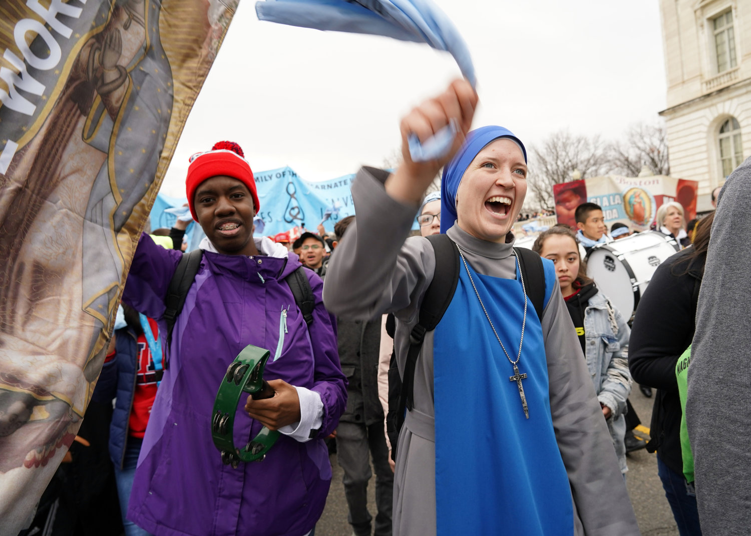 A religious sister sings and waves a cloth while participating in the 47th annual March for Life in Washington Jan. 24, 2020.